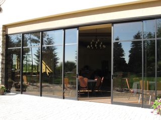 Solar innovations solar innovations inc completes for Exterior multi track sliding doors